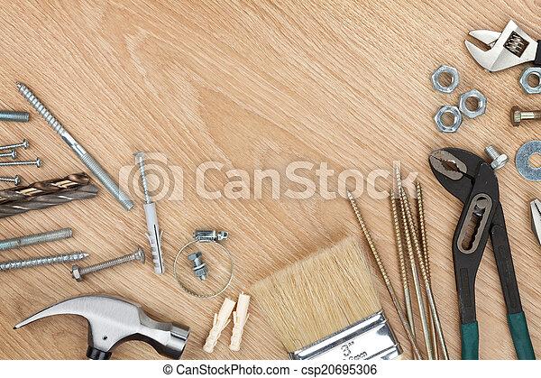 Set of tools on wood background - csp20695306