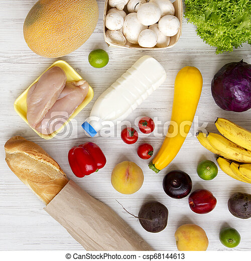 Set of various healthy food on a white wooden table, top view. Cooking food background. Healthy food concept. Close-up. - csp68144613