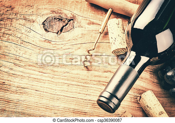 Setting with bottle of red wine and corks. Wine list concept - csp36390087