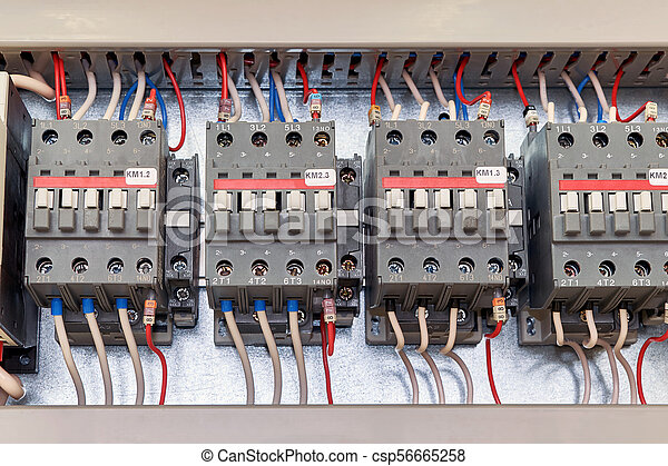 Several Electrical Contactor On A Mounting Panel In Electrical Closet.  Modern Contactors To Start Motors, Pumps And Other Equipment. Contactors  Connected To ...