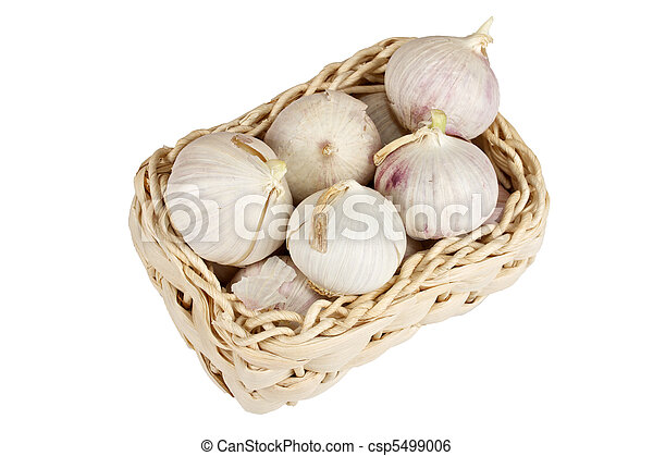 Several garlic onions in a basket isolated - csp5499006