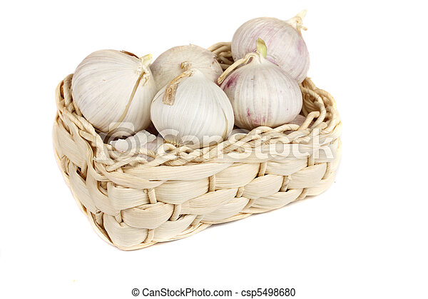 Several garlic onions in a basket isolated - csp5498680