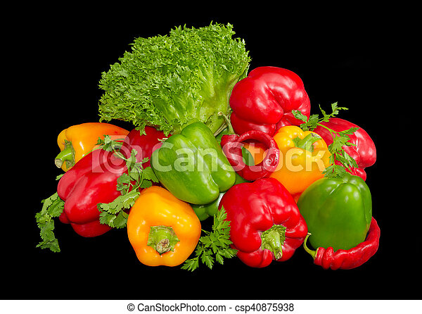 Several green, yellow and red bell peppers among the greens - csp40875938