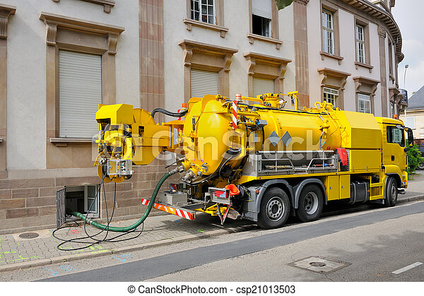 Sewage truck working in urban city environment - csp21013503