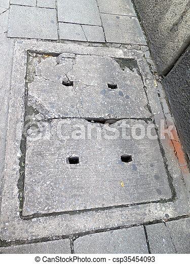 Sewer manhole on the urban asphalt road - csp35454093