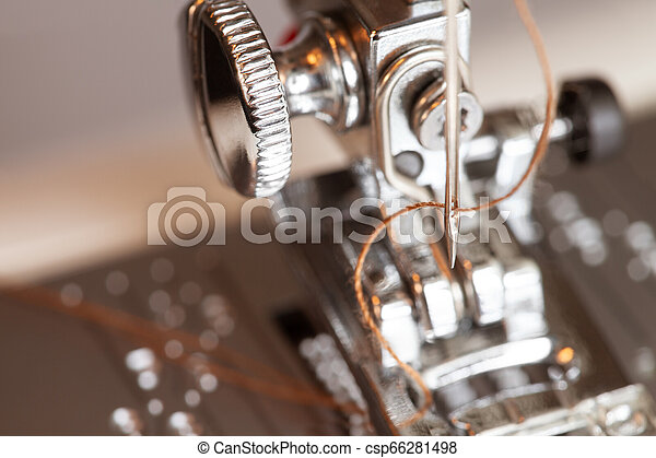 Sewing machine with thread in needle details - csp66281498