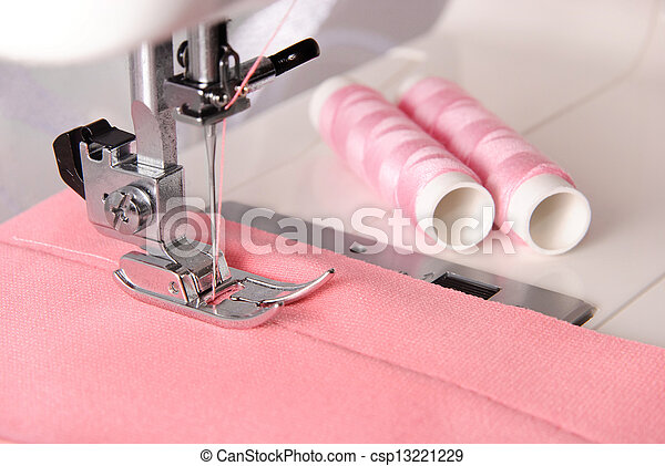 sewing process of rosy cloth on the machine and two bobbins - csp13221229