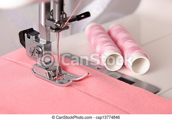 sewing process of rosy cloth on the machine and two bobbins - csp13774846