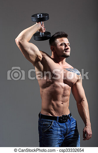 sexy athlete in denim shorts. with dumbbells - csp33332654