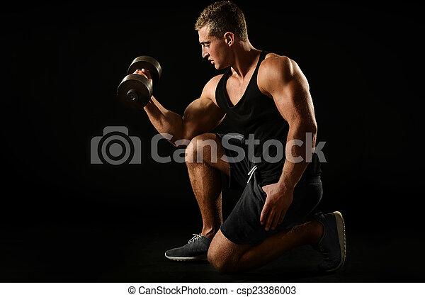Sexy athlete with dumbbel - csp23386003