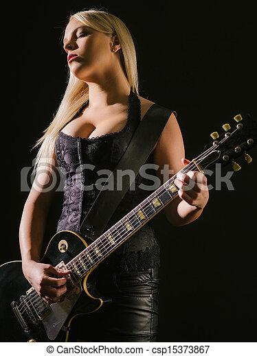 Sexy blond female playing electric guitar - csp15373867