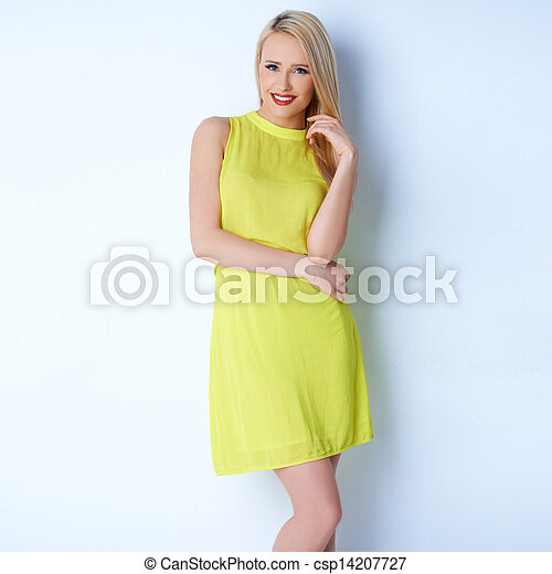 Sexy blond woman in yellow dress - csp14207727