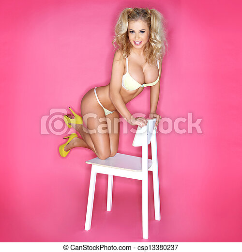 Sexy Blonde Woman In Bikini Kneeling On Chair - csp13380237
