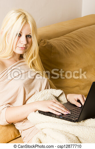 Sexy blonde woman on the bed - csp12877710