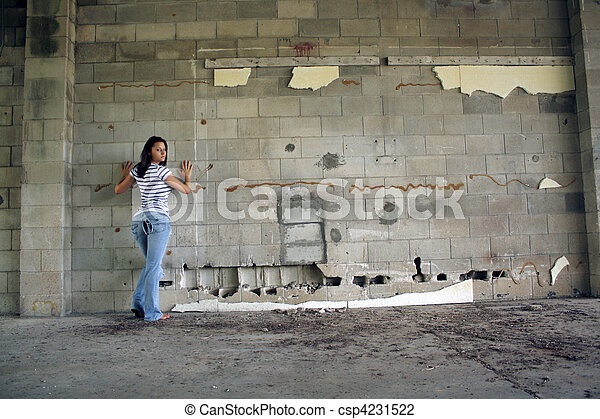 Sexy Brunette at a Block Wall (2) - csp4231522