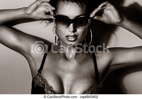 Sexy brunette posing with sunglasses  - csp6843402