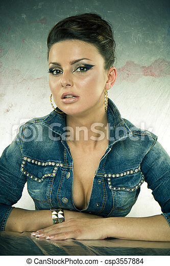 Sexy brunette woman in denim jacket - csp3557884