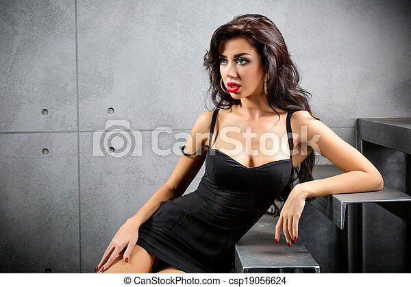 Sexy Brunette Woman Sitting On Stairs Csp19056624