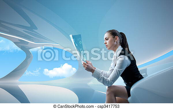 Sexy businesswoman examining future digital report / newspaper - csp3417753