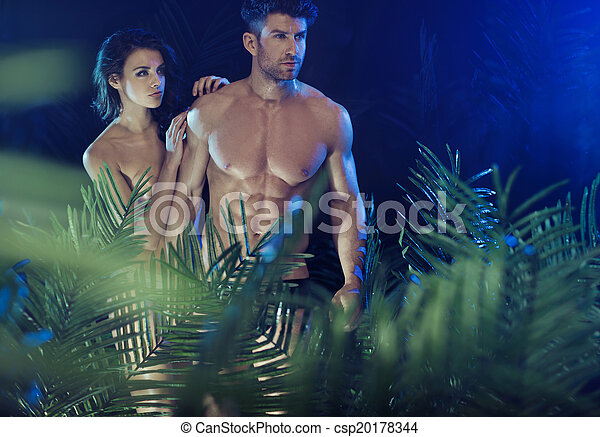 Sexy couple among the tropical plants - csp20178344