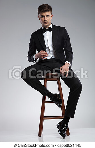Terrific Sexy Elegant Man In Black Tuxedo Sitting On Wooden Chair Ocoug Best Dining Table And Chair Ideas Images Ocougorg