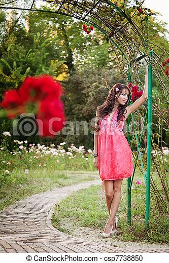 Sexy elegant woman posing outdoor - csp7738850