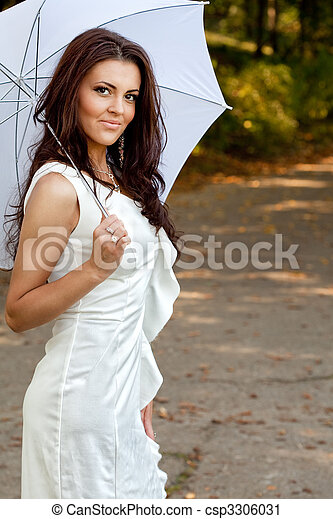Sexy elegant young woman with umbrella - csp3306031