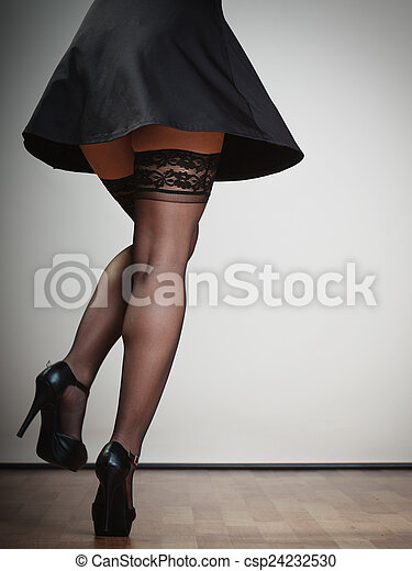 1bad8927f41 Sexy female legs in dance. girl in black dress stockings and high heels  dancing. party.