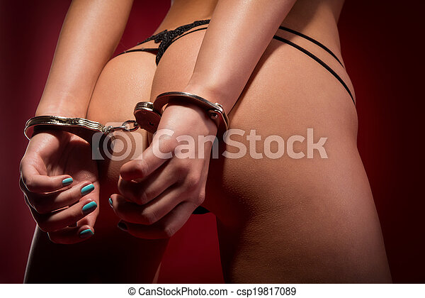 sexy girl from behind in handcuffs - csp19817089