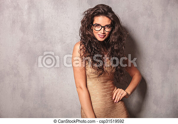 Sexy Girl Wearing Glasses Poses Smiling And Looking At The Camera Csp31519592