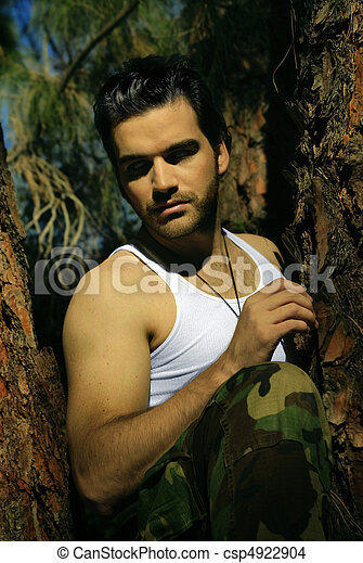 Sexy guy in tree - csp4922904