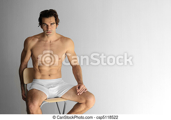 Sexy guy on stool - csp5118522