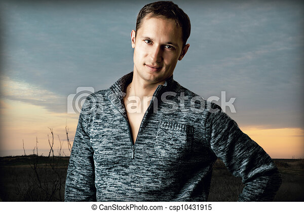 Sexy handsome man smiling  - csp10431915