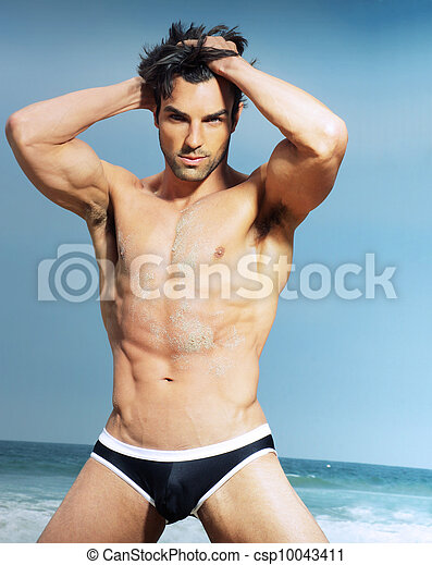 Sexy male model in fashion swimwear posing  - csp10043411