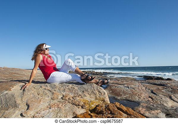 Sexy mature woman beach - csp9675587
