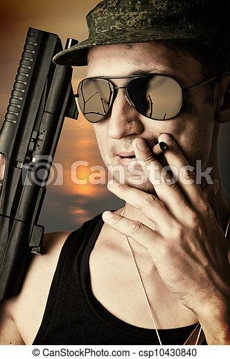 sexy military man wearing  sunglasses - csp10430840