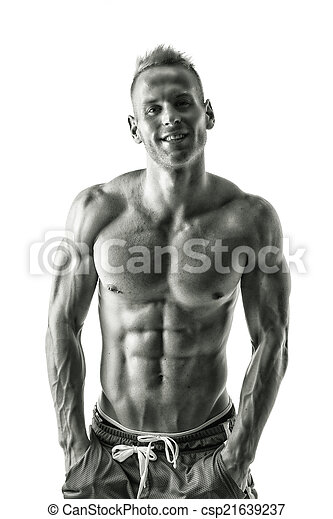 Sexy muscular blond shirtless male model smiling - csp21639237