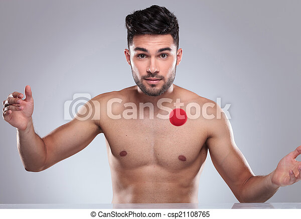 sexy naked young man playing with a red ball - csp21108765