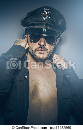 Sexy police concept, dangerous man with sunglasses - csp17482560