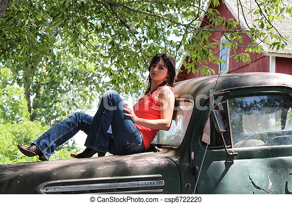 Sexy pose with truck. Young model posing with 1950 ford truck.