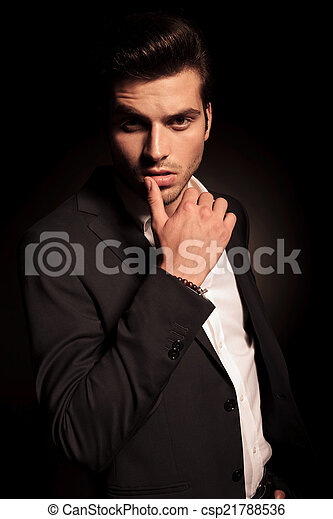 sexy provocative pose of a young fashion man - csp21788536
