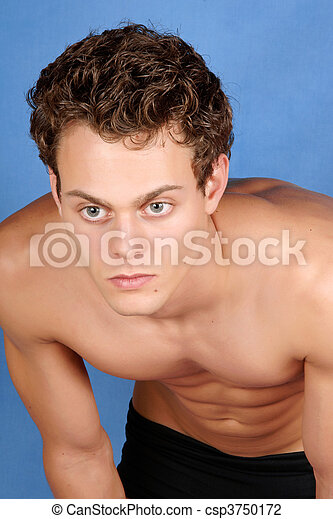Sexy Shirtless Young Man With Blue Eyes And Brown Hair Over A Blue