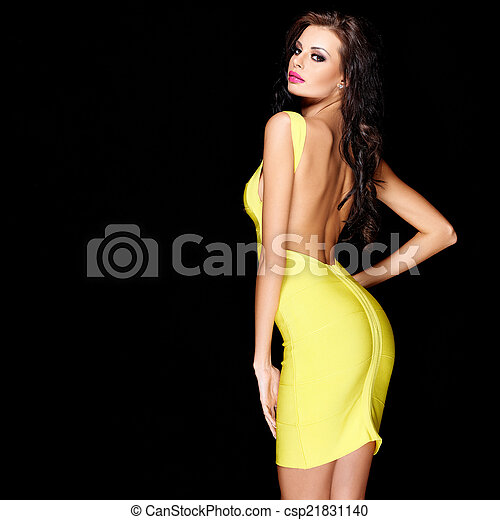 Sexy slim brunette posing in yellow dress - csp21831140