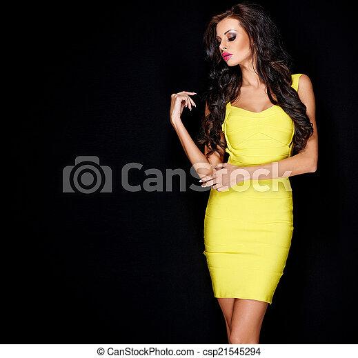 Sexy slim brunette posing in yellow dress - csp21545294