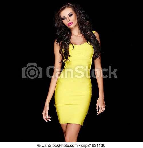 Sexy slim brunette posing in yellow dress - csp21831130