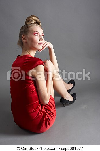 Sexy slim woman in red dress - csp5601577