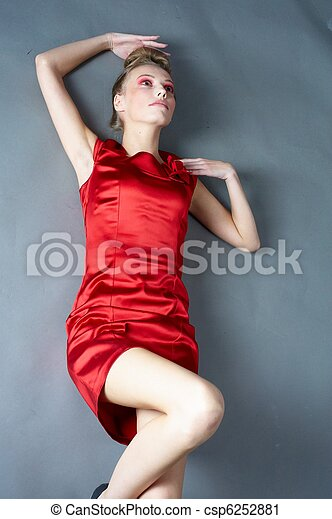 Sexy slim woman in red dress - csp6252881