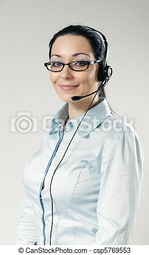 Sexy smiling call center operator portrait. Sexy girl wearing headset and glasses standing on uniform background. One of a series. - csp5769553