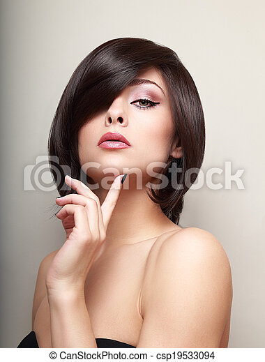 Sexy thinking alluring girl with short black hair - csp19533094
