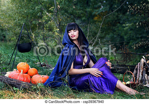 sexy witch near pumpkins - csp39367940